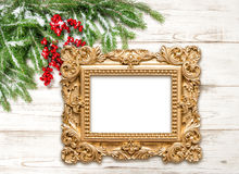 Christmas decoration with golden picture frame on wooden backgro Royalty Free Stock Images