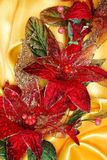 Christmas decoration on golden sateen. With flowers royalty free stock photography