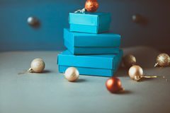 Christmas decoration on gray table and gift blue cardboard box Stock Image