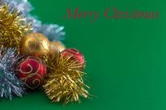 Christmas decoration on green background. Christmas decoration, red gold and silver, on green background Stock Photo