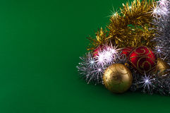 Christmas decoration on green background. Christmas decoration, red gold and silver, on green background Stock Image