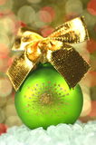Christmas decoration, green Christmas ball with golden bow Royalty Free Stock Image