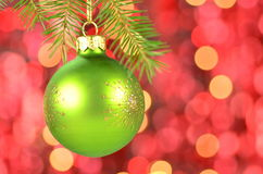 Christmas decoration, green Christmas ball hanging on spruce twig Stock Images