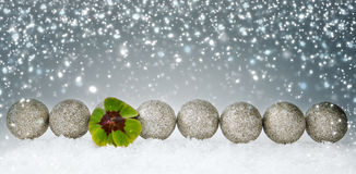 Christmas decoration with green clover leaf and silver balls. stock photo
