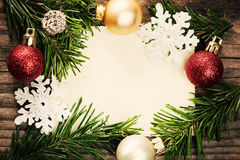 Christmas Decoration and Green Fir Branch on Blank Paper Royalty Free Stock Image