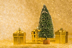 Christmas decoration. Green fir covered with snow and present shaped Christmas decorations Stock Photography