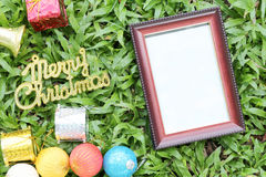 Christmas decoration on a green lawn and have gold text of Merry Royalty Free Stock Images
