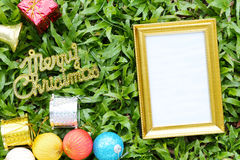 Christmas decoration on a green lawn and have gold text of Merry Royalty Free Stock Photos