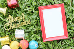 Christmas decoration on a green lawn and have gold text of Merry Royalty Free Stock Photography