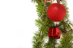 Christmas decoration with green pine or fir and red round orname Stock Photo