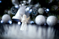 Christmas decoration with green pine, garland, white angel Royalty Free Stock Images