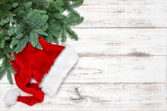 Christmas decoration green pine tree branches. Christmas decoration and green pine tree branches on bright wooden background stock images