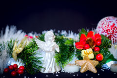 Christmas decoration with green pine, white angel at black background Royalty Free Stock Images