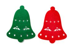 Christmas decoration of a green and red flat bells on white. Background Stock Photos