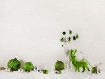 Christmas decoration: green reindeer on wooden white background. Royalty Free Stock Photography