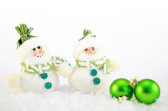 Christmas decoration. Green christmas decoration with snowman and snow Royalty Free Stock Photos