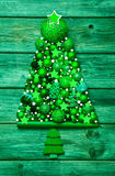 Christmas decoration in green: tree of different balls on wood. Stock Images