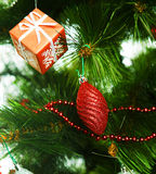 Christmas decoration on green tree Royalty Free Stock Images