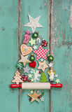 Christmas decoration on a green wooden background as a christmas. Christmas decoration on a green wooden background for a christmas card royalty free stock photo