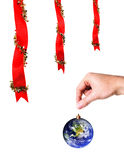 Christmas decoration and hand holding  earth Stock Images