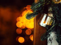 Christmas decoration hanging from door. Christmas decorationmade with a glass vase and a candle inside with some christmas tree 's branch hanging from door with Stock Image