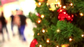 Christmas decoration- hanging lanterns with holly stock footage