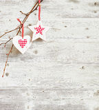 Christmas decoration hanging over grunge wooden board painted white. Stock Image
