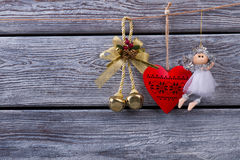 Christmas decoration hanging over wooden background. Royalty Free Stock Photography