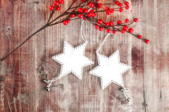 Christmas decoration hanging over wooden background Royalty Free Stock Photography