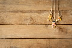 Christmas decoration hanging on wood background with space. Stock Images