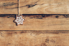 Christmas decoration hanging on wood background texture with cop Stock Photos
