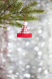 Christmas Decoration. Christmas hat decoration on pine tree branch Royalty Free Stock Image