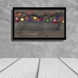 Christmas decoration with hdtv on concrete wall background.  stock photos
