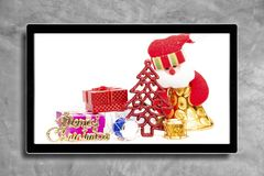 Christmas decoration with hdtv on concrete wall background.  royalty free stock photography