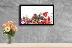 Christmas decoration with hdtv on concrete wall background.  royalty free stock photo