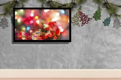 Christmas decoration with hdtv on concrete wall background.  royalty free stock photos