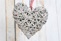 Christmas decoration heart-shaped. Toy wood heart  on wooden background Stock Photo