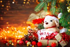 Christmas Decoration, Holiday Plush Dog With Gifts Under The Christmas Tree. With New Year And Christmas. Stock Photography