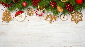 Christmas decoration with holiday tree branches, ball toys, gingerbread cookies.  royalty free stock photo