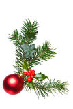 Christmas decoration with holly and bauble. Stock Photography