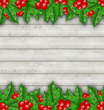 Christmas decoration holly berry branches on wooden background. Illustration Christmas decoration holly berry branches on wooden background - vector Stock Photo