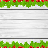 Christmas decoration with holly berry on wooden background Stock Image