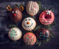 Christmas decoration on donuts Stock Images