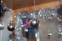 Christmas decoration two silver balls. Christmas decoration for the house and the Christmas tree, silver shining ball Stock Photography