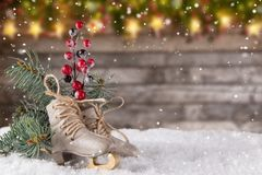 Christmas decoration ice skates on wooden background. Lots of copy space for your product or text Royalty Free Stock Photography