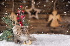 Christmas decoration ice skates on wooden background. Lots of copy space for your product or text Royalty Free Stock Image