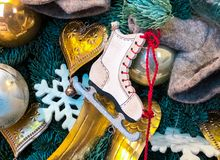 Christmas decoration with ice skating shoes, balls and hearts royalty free stock photos