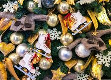 Christmas decoration with ice skating shoes, balls and hearts stock image