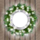 Christmas decoration. Illustration of Christmas decoration with round banner, fir tree branches, mistletoe, lights and wooden background Stock Image