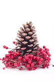 Christmas decoration isolated on white. Pine cone and red berries Christmas decorations Royalty Free Stock Photo